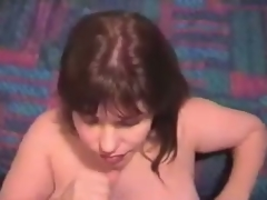 Doyenne wife strokes man's penis, seizing quickening with her hands and takes luxuriant cumshot on her face.