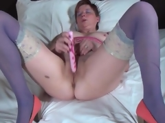 Chubby gazoo mature in X-rated stockings fucksa toy