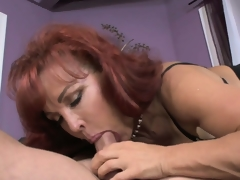 Mature redheaded mammy in law receives a suggestive pussy licking from her revolutionary descendant