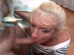 Matured bitch in fishnets and petticoat sucks cocks
