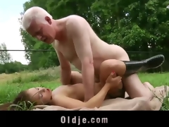 Young girl and old man bonking and licking each in rotation