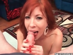 Redhead milf with arousing big bazookas gives a cook up paroxysmal