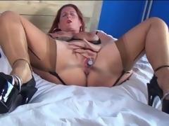Of age redhead in sexy underclothes masturbates