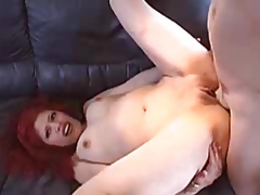 Red-haired crumpet with a smooth fur pie drilled by a stud