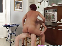 Mature redheaded milf sucks Hawkshaw after shagging young stud