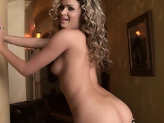 Blond MILF with a very smashing ass poses and works their way fingers and pussy trinket