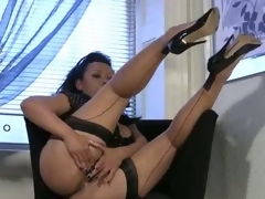 Bigtit milf in stockings rubs the brush mature pussy