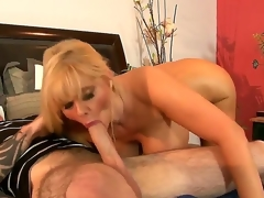 Experienced alluring mature golden-haired milf Karen Fisher with big juicy booty added to mammoth hang hooters gives head to younger tattooed chap added to rides on his burly hard screw-up on bed