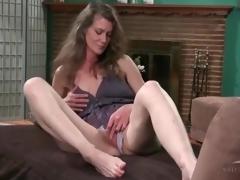 Cute mature in lace panties erotically masturbates