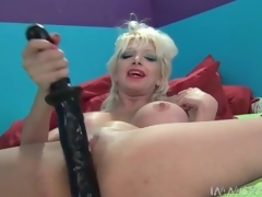 Milf prevalent whore makeup fucks her pussy with a large bagatelle
