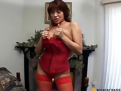 MILF with big breasts licks locate