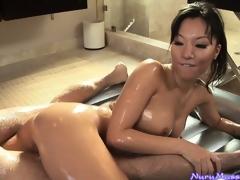 Oriental indulge Asa Akira sucking a guy's cock after a slutty nuru massage