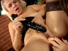 Trashy lesbo grannies Marketa And Leona skunk their juicy pussies and sharing a giant dildo