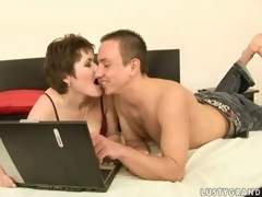Sexy mature woman and a randy clothes-horse host dote on