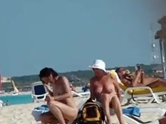 Naked mature wife gets a stranger to rub sun lotion out of reach of her back, tiny boobs and little hair visible.
