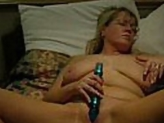 Enjoyable quality video and audio.  This mature blonde babe has her legs widen nearby and a dildo stuck in her pussy.  That babe masturbates to orgasm.