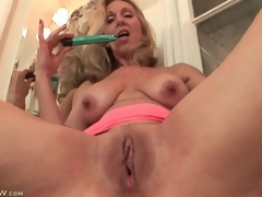 Mature plays with their way tits and pussy in bathroom