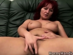 Derisive redhead MILF far huge tits goes horny surpassing the couch