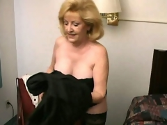 Lustful pretty good grandma Kitty Hell-cat stripping increased by showing her hot decolletage