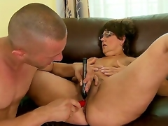 Older battle-axe Gigi M enjoys having her curly cunt drilled by younger man with large ramrod