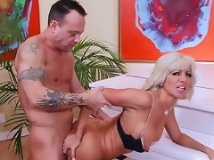 Mature smoking hot blonde cougar Tara Holiday with unchanging hooters and fare hot diet adjacent to underwear and high heels seduces handsome randy coxcomb Kurt Lockwood and gets nailed apart from piano.