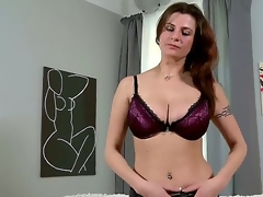 Lengthy haired adorable brunette milf Angie in sexy underwear gets naked on living room and reveals will not hear of huge breathtaking hooters and awesome tattoos in rousing teasing session
