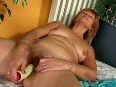 Lustful redhead granny Lady ribbons a giant vibrator with lust