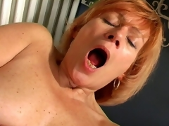 Appealing granny Lady spreads cunt together with copulates a massive white dildo