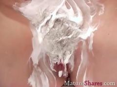 Shaving her elderly pussy