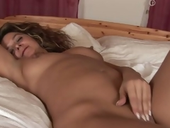 MILF Emanuelle masturbating in will not hear of bed